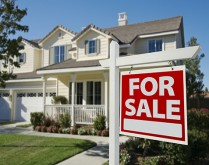 Home For Sale Sign in Front of New House.