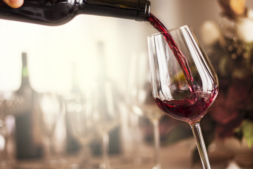 red wine pouring in a restaurant